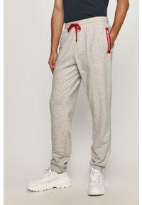 Szare spodnie dresowe Emporio Armani z nadrukiem