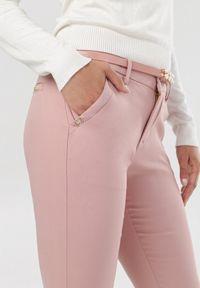 Różowe spodnie materiałowe Born2be