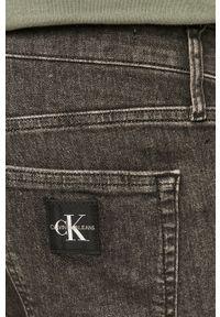 Calvin Klein Jeans - Szorty jeansowe. Okazja: na co dzień. Kolor: szary. Styl: casual