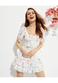 LOVE SHACK FANCY - Wzorzysta mini sukienka Violet. Typ kołnierza: kołnierz z falbankami. Kolor: biały. Materiał: bawełna, materiał. Wzór: kwiaty. Typ sukienki: rozkloszowane. Długość: mini