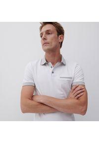 Reserved - Koszulka polo z bawełnianej dzianiny - Biały. Typ kołnierza: polo. Kolor: biały. Materiał: bawełna, dzianina