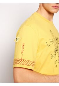 Puma T-Shirt MICHAEL LAU 2Sho Tee 530361 Żółty Regular Fit. Kolor: żółty