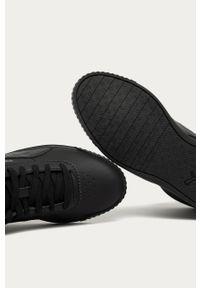 Czarne buty sportowe Puma z okrągłym noskiem, na średnim obcasie