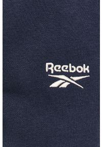 Niebieskie spodnie dresowe Reebok Classic z aplikacjami