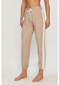 DKNY - Dkny - Spodnie piżamowe. Kolor: beżowy