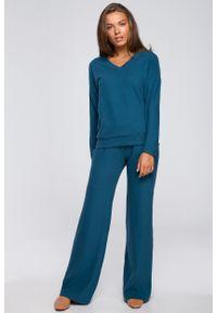 MOE - Niebieskie Dzianinowe Spodnie z Luźną Nogawką. Kolor: niebieski. Materiał: dzianina