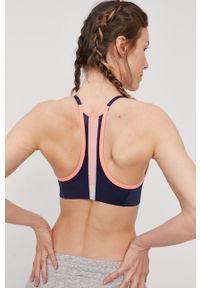 Nike - Biustonosz sportowy Indy. Kolor: pomarańczowy