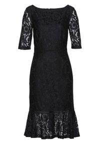Sukienka koronkowa z falbaną w dolnej części bonprix czarny. Kolor: czarny. Materiał: koronka. Wzór: koronka