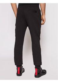 Versace Jeans Couture Spodnie dresowe A2GWA13F Czarny Regular Fit. Kolor: czarny. Materiał: dresówka