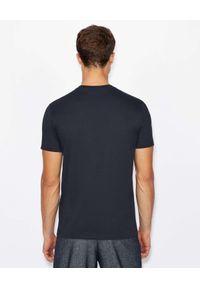 Armani Exchange - ARMANI EXCHANGE - Czarny t-shirt z dużym nadrukiem. Kolor: czarny. Materiał: materiał. Wzór: nadruk