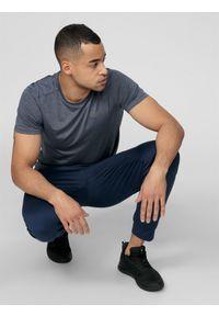 Niebieskie spodnie sportowe 4f