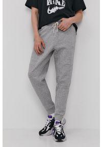 Nike Sportswear - Spodnie. Kolor: szary. Materiał: dzianina, materiał, włókno