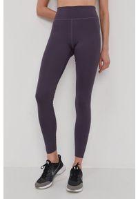 Nike - Legginsy. Kolor: fioletowy. Materiał: tkanina, dzianina, skóra, włókno. Technologia: Dri-Fit (Nike)