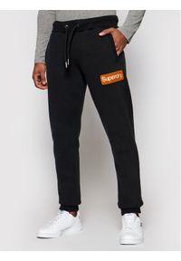 Superdry Spodnie dresowe Cl Workwear M7010552A Czarny Regular Fit. Kolor: czarny. Materiał: dresówka