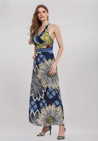 Renee - Granatowa Sukienka Satirise. Kolor: niebieski. Materiał: tkanina. Długość rękawa: bez rękawów. Wzór: kwiaty, kolorowy. Typ sukienki: rozkloszowane. Styl: boho. Długość: maxi