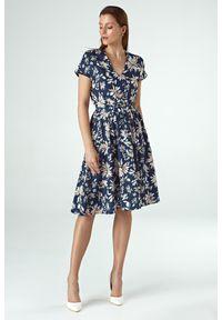 e-margeritka - Sukienka rozkloszowana wizytowa - 38. Okazja: do pracy, na imprezę. Materiał: tkanina, materiał, poliester. Wzór: kwiaty. Typ sukienki: rozkloszowane. Styl: wizytowy. Długość: midi