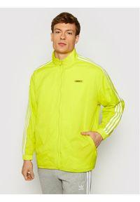 Adidas - adidas Kurtka przejściowa Reverse Track GN3818 Żółty Regular Fit. Kolor: żółty