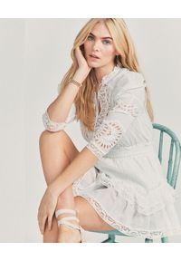 LOVE SHACK FANCY - Bawełniana mini sukienka Isidore. Kolor: biały. Materiał: bawełna. Typ sukienki: rozkloszowane. Długość: mini