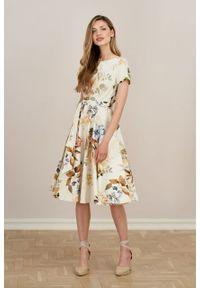 Marie Zélie - Sukienka Alana Geodetia kremowa. Typ kołnierza: kokarda. Kolor: kremowy. Materiał: bawełna, skóra, materiał, elastan. Długość rękawa: krótki rękaw. Styl: wizytowy, elegancki