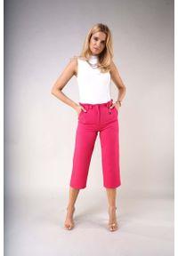 Różowe spodnie z wysokim stanem Nommo eleganckie