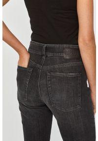 Czarne jeansy bootcut Diesel z podwyższonym stanem