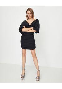 ALEXANDRE VAUTHIER - Czarna sukienka z głębokim dekoltem. Kolor: czarny. Materiał: materiał. Styl: elegancki, klasyczny. Długość: mini