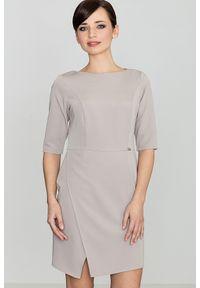 e-margeritka - Elegancka sukienka do biura beżowa - xl. Okazja: do pracy, na spotkanie biznesowe. Kolor: beżowy. Materiał: tkanina, wiskoza, materiał, poliester. Typ sukienki: proste, asymetryczne, wyszczuplające. Styl: biznesowy, elegancki. Długość: midi