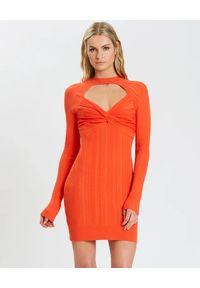 HERVE LEGER - Pomarańczowa sukienka w prążki. Okazja: na imprezę. Kolor: pomarańczowy. Materiał: materiał. Długość rękawa: długi rękaw. Wzór: prążki. Styl: klasyczny. Długość: mini