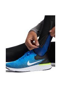 Spodnie męskie do biegania Nike Run Mobility AT4238. Materiał: materiał, elastan, włókno, skóra, poliester. Technologia: Dri-Fit (Nike). Wzór: gładki. Sport: bieganie