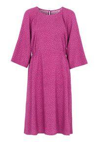 Cellbes Wzorzysta sukienka z raglanowymi rękawami w kropki female ze wzorem 42/44. Materiał: tkanina, guma. Długość rękawa: raglanowy rękaw. Wzór: kropki. Styl: klasyczny