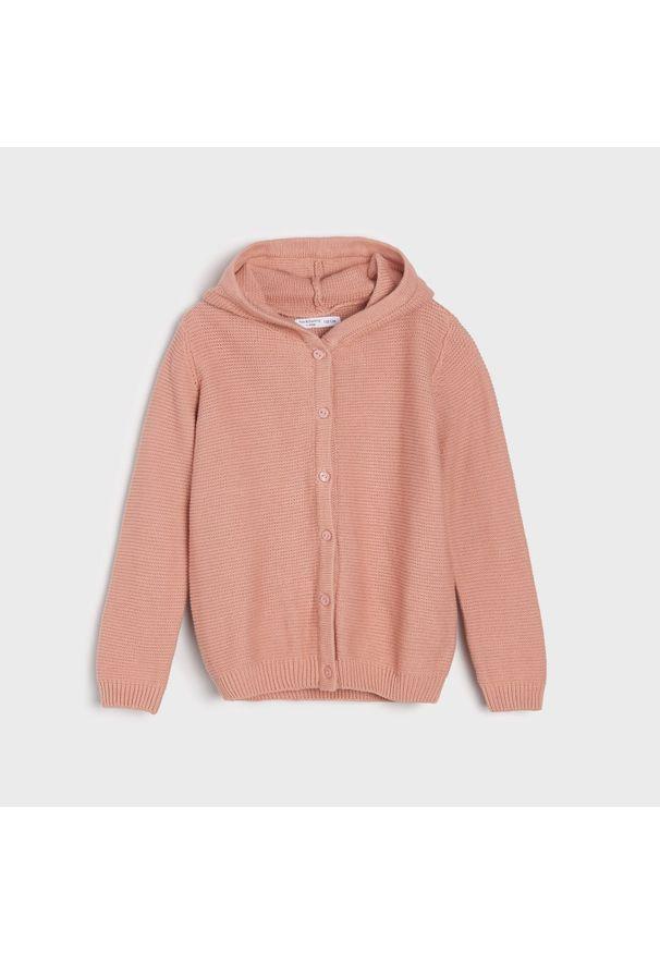 Różowy sweter Sinsay z kapturem