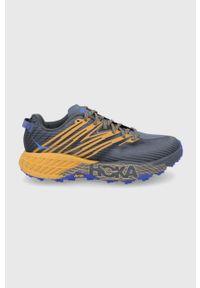 Hoka One One - Buty Speedgoat 4. Nosek buta: okrągły. Zapięcie: sznurówki. Kolor: szary. Materiał: guma. Wzór: geometria. Sport: bieganie