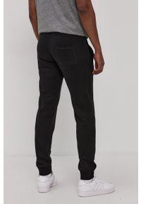 Superdry - Spodnie. Okazja: na co dzień. Kolor: czarny. Materiał: dzianina. Styl: casual