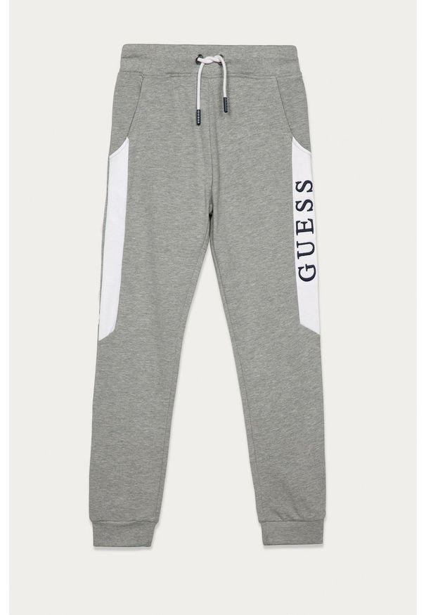 Szare spodnie dresowe Guess Jeans z aplikacjami