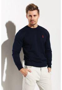 Niebieski sweter Edward Orlovski elegancki, z haftami