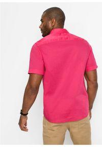 Koszula z krótkim rękawem bonprix różowy hibiskus. Typ kołnierza: kołnierzyk włoski. Kolor: różowy. Materiał: materiał. Długość rękawa: krótki rękaw. Długość: krótkie. Sezon: lato