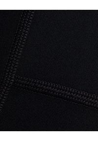 GIRLFRIEND COLLECTIVE - Czarne legginsy z kieszeniami 7/8. Stan: podwyższony. Kolor: czarny. Materiał: tkanina, materiał