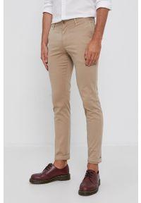 TOMMY HILFIGER - Tommy Hilfiger - Spodnie. Okazja: na co dzień. Kolor: beżowy. Materiał: tkanina. Wzór: gładki. Styl: casual
