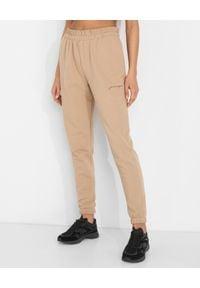 JENESEQUA - Bawełniane spodnie dresowe. Kolor: beżowy. Materiał: dresówka, bawełna