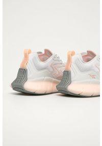 Białe buty sportowe Reebok na sznurówki, na niskim obcasie