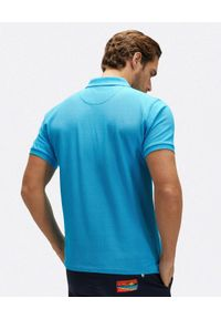 North Sails - NORTH SAILS - Niebieska koszulka polo z haftowanym logo. Typ kołnierza: polo. Kolor: niebieski. Materiał: bawełna. Wzór: haft