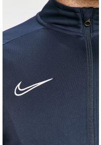 Niebieski komplet dresowy Nike Sportswear z aplikacjami