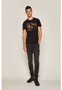 Czarne jeansy medicine w kolorowe wzory