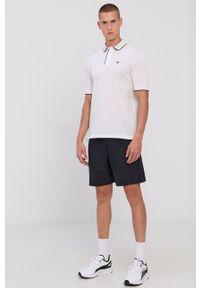 Emporio Armani - Polo bawełniane. Okazja: na co dzień. Typ kołnierza: polo. Kolor: biały. Materiał: bawełna. Długość: krótkie. Wzór: aplikacja. Styl: casual