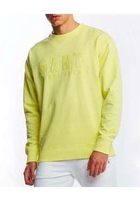 GANT - Żółta bluza z monochromatycznym logo. Kolor: żółty. Materiał: bawełna. Długość rękawa: długi rękaw. Długość: długie