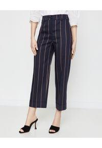 CAPPELLINI - Granatowe spodnie w paski. Stan: podwyższony. Kolor: niebieski. Materiał: len, prążkowany. Wzór: paski