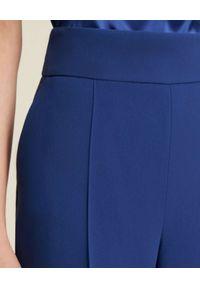 Luisa Spagnoli - LUISA SPAGNOLI - Niebieskie spodnie Oisy. Stan: podwyższony. Kolor: niebieski. Materiał: materiał