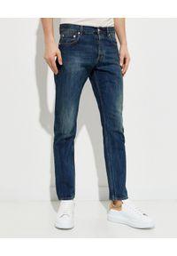 Alexander McQueen - ALEXANDER MCQUEEN - Granatowe jeansy z przetarciami. Kolor: niebieski