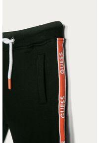 Czarne spodnie dresowe Guess na co dzień, z aplikacjami