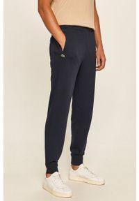 Niebieskie spodnie dresowe Lacoste